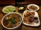 Delicious dinner of loofah, pigs blood and tofu, pigs ears, and some of the best chicken I've ever had